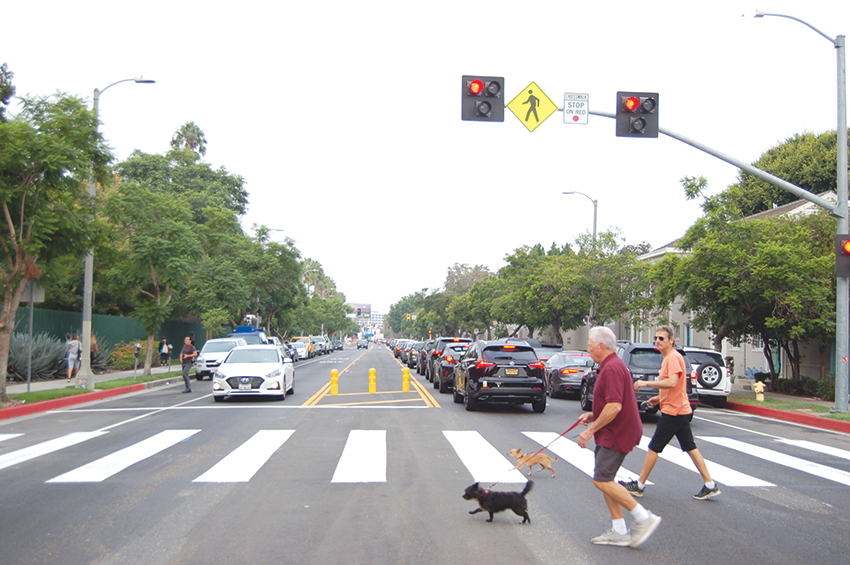 The HAWK signal uses red and yellow lights to slow car traffic for pedestrians who wish to cross. (photo by Edwin Folven)