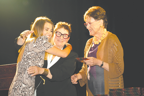 Amanda Hyatt accepts her scholarship from the Ebell's Director of Scholarship Judith Day and President Ginger Barnard on Sept. 12. (photo courtesy of the Ebell of Los Angeles)