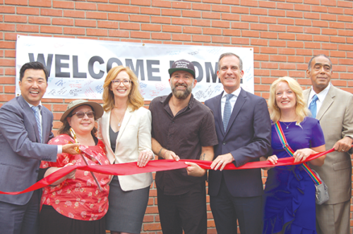 Los Angeles City Councilman David Ryu cut a ribbon at the opening of the new Gardner Street Women's Bridge Housing Center and was joined by city, county and state officials. (photo by Edwin Folven)