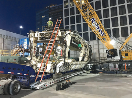 The machines that previously excavated subway tunnels between La Brea and Western avenues are being removed from the ground and transported back to the Wilshire/La Brea staging yard. (photo courtesy of Metro)