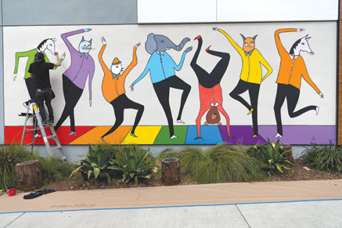 "Mike Stilkey's mural, ""You're All Welcome Here,"" greets visitors at West Hollywood City Hall (photo by Jon Viscott)"