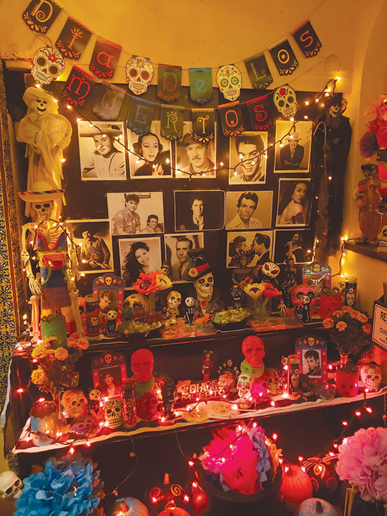 A Día de los Muertos altar at Antonio's Mexican Restaurant on Melrose Avenue pays tribute to entertainers who have passed away, such as Prince and Eddie Money. (photo by Cameron Kiszla)