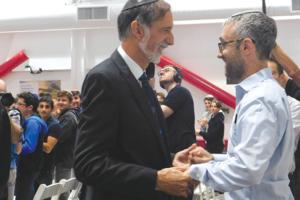 Rabbi Abraham Lieberman and Rabbi David Stein embrace after Lieberman received a Jewish Educator Award at Shalhevet High School. (photo by Kate Dietel)