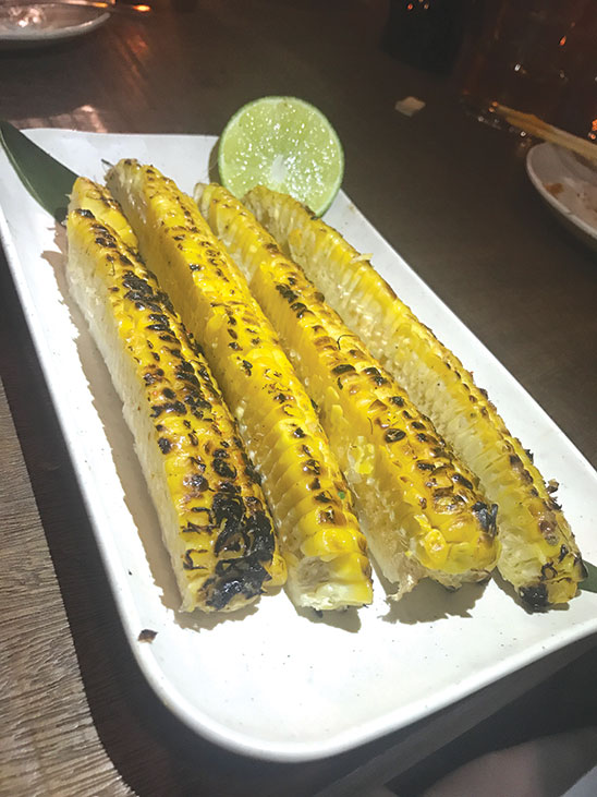 Corn charred on the robata grill gets a kick from shichimi, a seven-ingredient spice blend including red chili pepper, nori and ginger. (photo by Jill Weinlein)