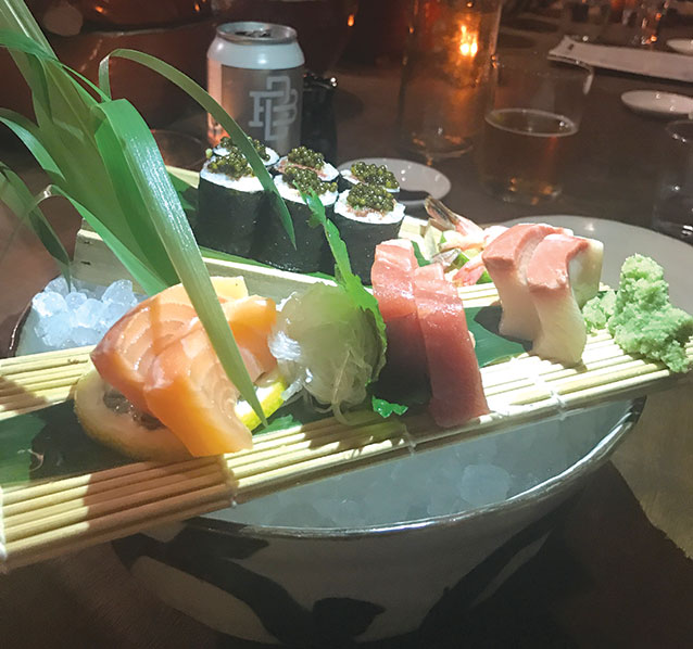 The artistically displayed sashimi consists of toro, akami, hamachi and tuna belly maki.  (photo by Jill Weinlein)