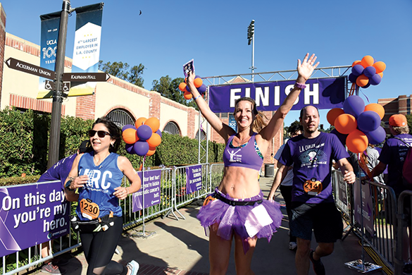 Julie Weiss, ambassador for the Hirshberg Foundation, crosses the finish line at the L.A. Cancer Challenge 5K, marking her 31st completed race this year. (photo courtesy of Angela Daves Haley)