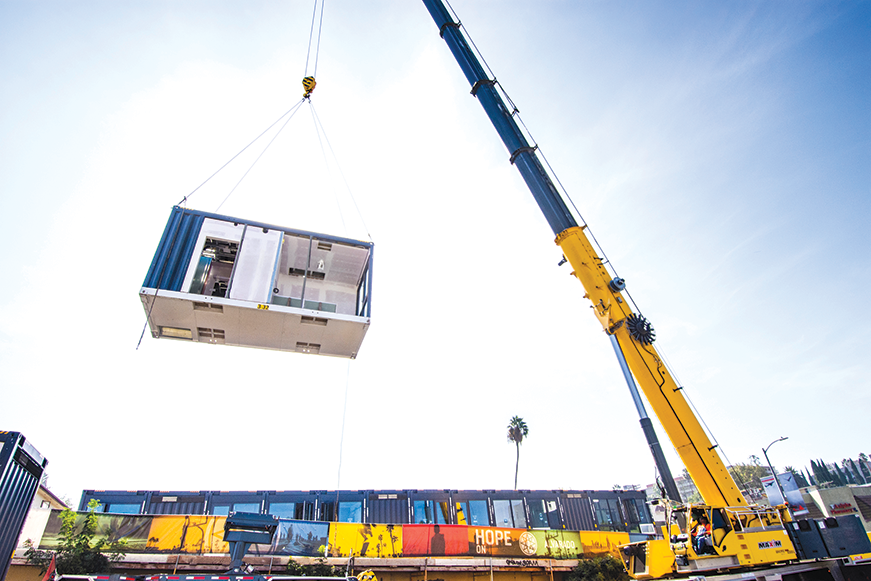 Modules that resemble shipping containers were hoisted into place to create the living quarters in the Hope on Alvarado project. (photo by John Bare)