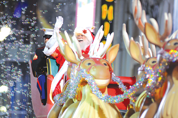 Santa Claus delights the crowd every year at the Hollywood Christmas Parade, held this Sunday starting at 5 p.m. with a concert. (photo by William Kidston/courtesy of the Hollywood Christmas Parade)