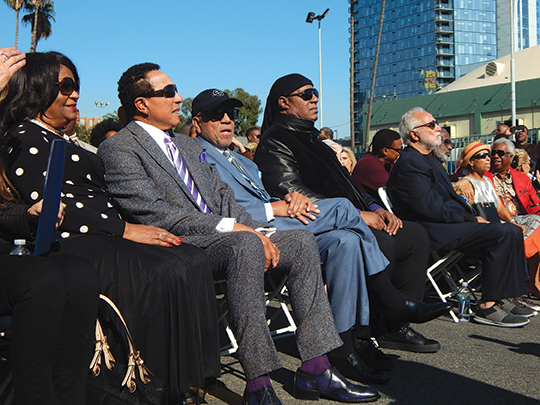Smokey Robinson and Stevie Wonder joined their friend Berry Gordy, center, for the ceremony at the intersection of Sunset Boulevard and Argyle Avenue, which was dedicated as Berry Gordy Square. (photo by Morgan Keith)
