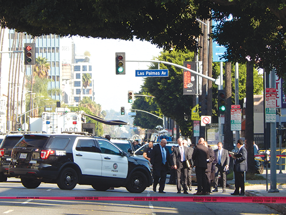 Sunset Boulevard was closed for hours as Los Angeles Police Department detectives investigated an officer-involved shooting in which an alleged robbery suspect was killed. (photo by Morgan Keith)
