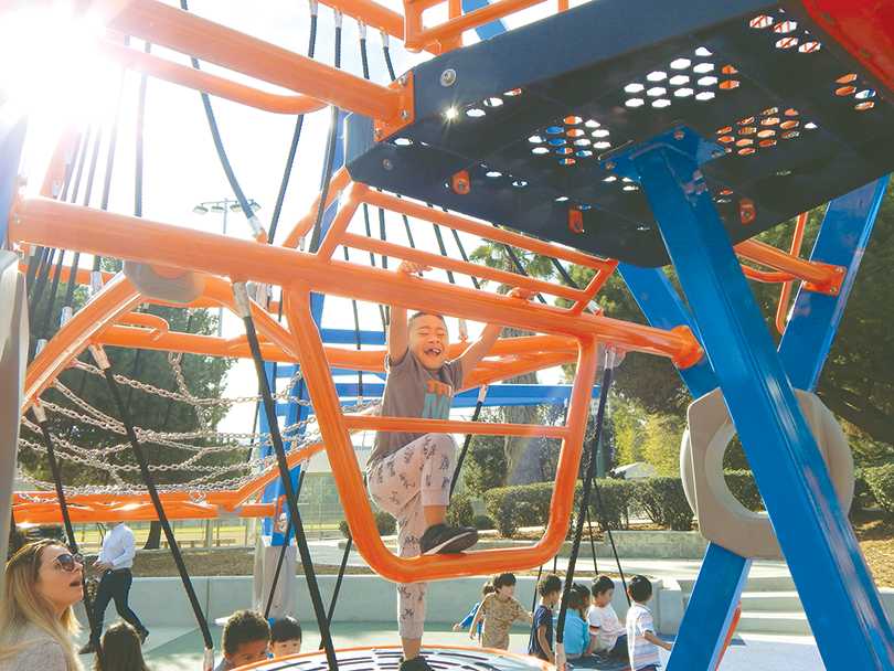 The new playground at Pan Pacific Park was a hit with children who used the new equipment on the day the play structures opened. (photo by Edwin Folven)