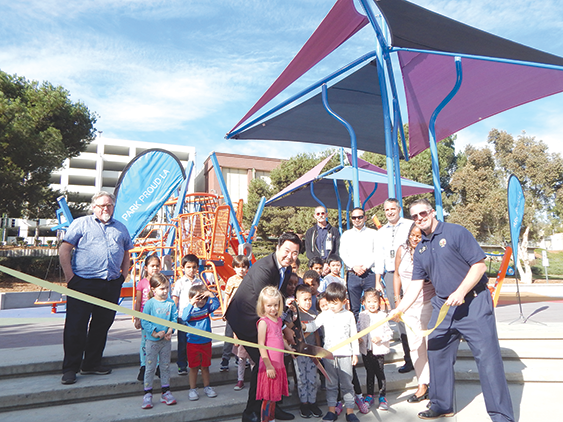 Los Angeles City Councilman David Ryu cut a ribbon for the new playground at Pan Pacific Park with representatives from the city, community members and children from a daycare center at the park. (photo by Edwin Folven)