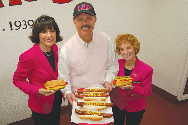 Pink's owners Richard, Gloria Pink (left) and Beverly Pink-Wolfe invite hot dog lovers to enjoy their chili dogs during its 80th anniversary celebration for just 80 cents, for 80 minutes starting at 8 p.m. on Nov. 8. (photo by Edwin Folven)