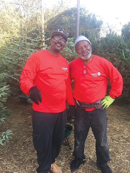 J.C. Clark (right) is one of the formerly incarcerated individuals who work each year at the Wilshire Rotary Christmas Tree lot, which helps them stay on track for success. (photo courtesy of R. Scot Clifford)