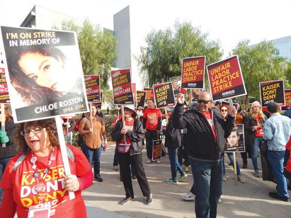 Members of the National Union of Healthcare Workers protested outside the Kaiser Permanente hospital in Hollywood. Some carried signs with photographs of people who took their own lives. (photo by Edwin Folven)
