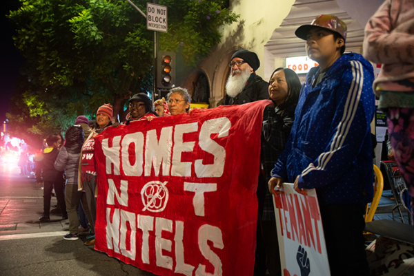 Protestors gathered at the Hollywood Christmas Parade to decry what they see as overdevelopment. (photo courtesy of Brandon Hauer)