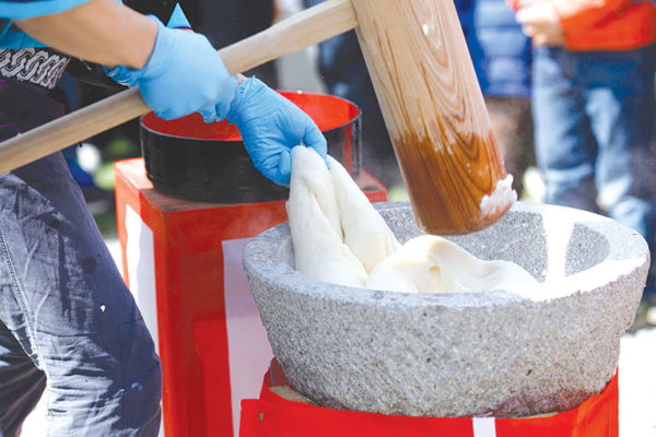 The Japanese culinary art of mochi-tsuki involves pounding rice in a large stone bowl to form a paste, which is used in traditional soups. (photo courtesy of Japan House Los Angeles)