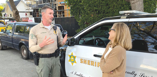 Lt. Bill Moulder, of the West Hollywood Sheriff's Station, met with West Hollywood West Residents Association President Leslie Karliss and encouraged victims to come forward. (photo courtesy of WHWRA)