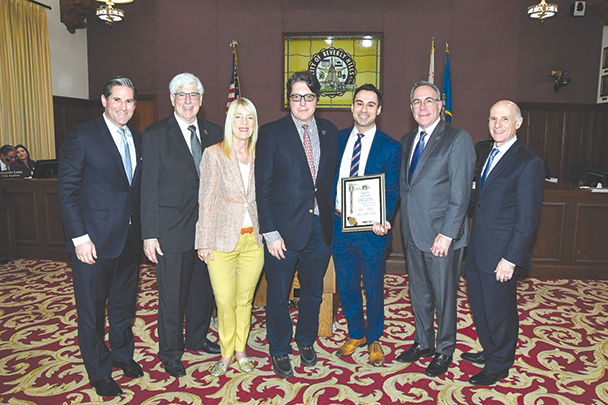 The Beverly Hills City Council recognized attorney Andrew A. Talebi, third from right, with a Kindness Award. Joining Talebi were Beverly Hills Human Relations Commission Chair Ori S. Blumenfeld, left, Beverly Hills City Councilman Julian Gold, Councilwoman Lili Bosse, Mayor John Mirisch, and Councilmen Lester Friedman and Bob Wunderlich. (photo courtesy of the city of Beverly Hills)