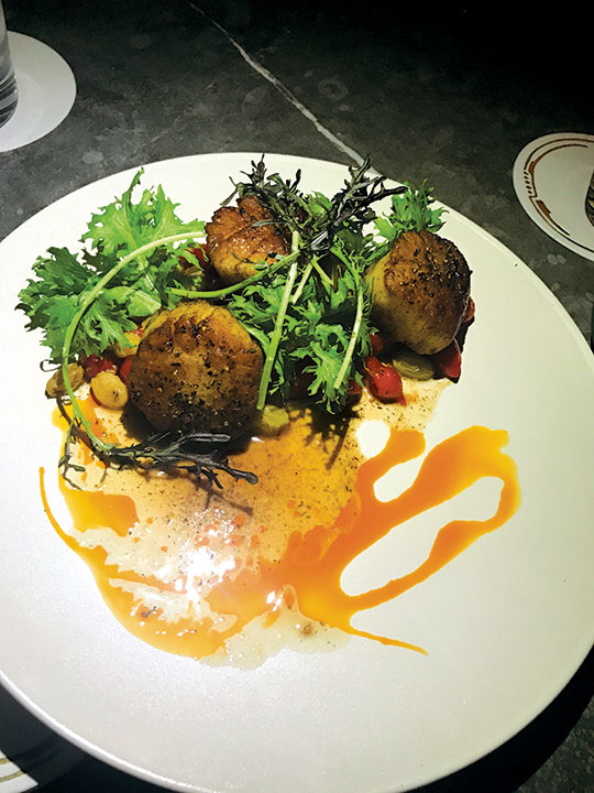 The caramelized scallops are seasoned with Mediterranean spices at Calabra at the Santa Monica Proper Hotel. (photo by Jill Weinlein)