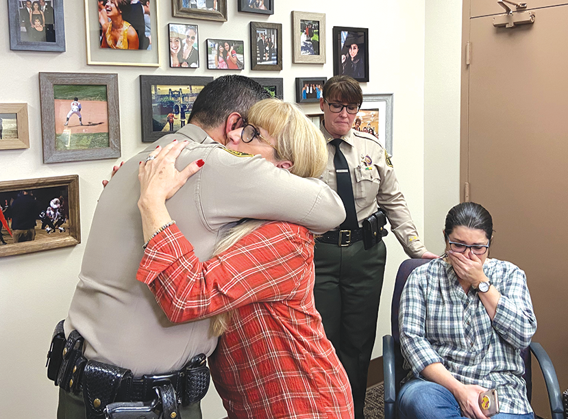 West Hollywood Sheriff's Station Capt. Edward Ramirez embraced Ellen Rose Leist, Det. Amber Leist's mother, at the station on Monday. Also present were Lt. Nancy McGauley and Leist's sister, Heather Ashor. (photo by Edwin Folven)