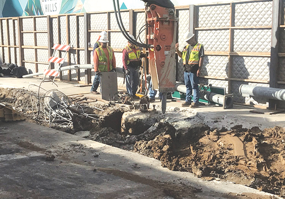 Crews are breaking up the street surface to prepare for pile installation for the Wilshire/Rodeo station in Beverly Hills. (photo courtesy of Metro)