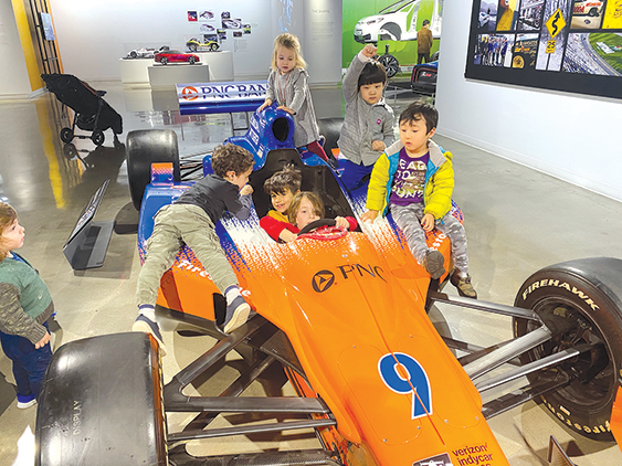 Children can participate in numerous activities at the Petersen Automotive Museum, including getting behind the wheel of a race car driven by Scott Dixon. (photo courtesy of the Petersen Automotive Museum)