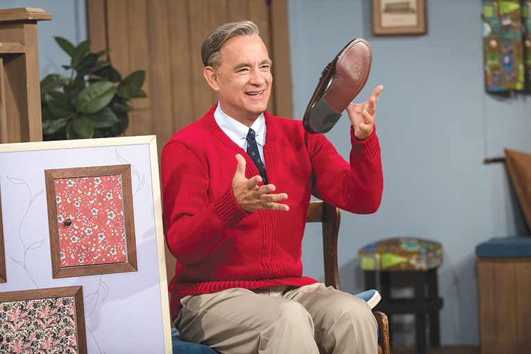 """Tom Hanks is compelling as Mr. Rogers in """"A Beautiful Day in the Neighborhood,"""" but the film falls short in capturing the true identity and motivation of the iconic television personality. (photo courtesy of Sony Pictures)"""