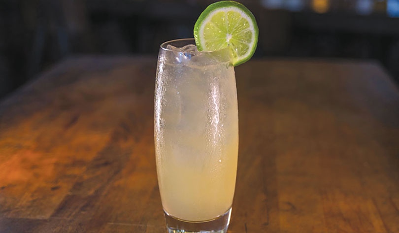 Order a Dusty Bottoms, made with tequila, lime, pineapple smoked bitters and ginger beer, and $1 goes to No Kid Hungry. (photo courtesy of Dog Haus)