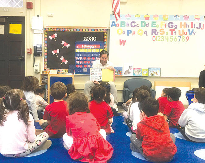 """Beverly Hills Human Relations Commission Chairman Ori Blumenfeld read """"The Kindness Book,"""" by Todd Parr, to preschoolers at Hawthorne Elementary School on Feb. 21. (photo courtesy of the city of Beverly Hills)"""