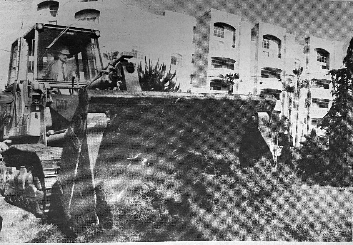 Developer Jonah Goldrich drives a bulldozer during a groundbreaking ceremony for the Los Angeles Holocaust Monument in Pan Pacific Park. (Park Labrea News/Beverly Press archives)