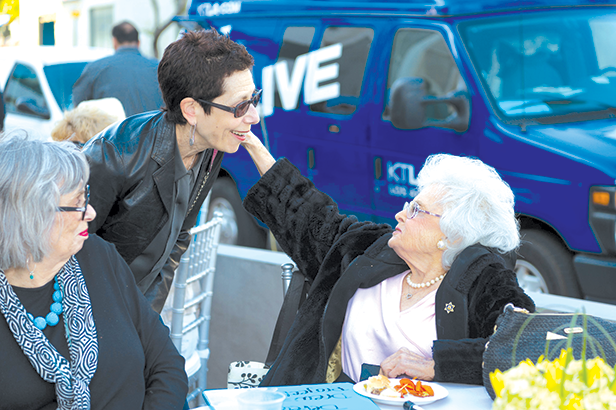 Jeanne Dobrin, right, was well-known for attending West Hollywood City Council meetings and speaking about local issues. She is shown speaking with former West Hollywood City Councilwoman Abbe Land. (photo courtesy of the city of West Hollywood)