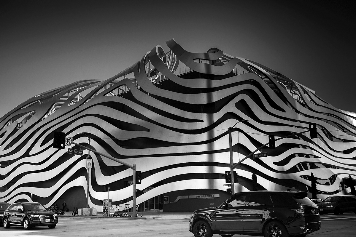 The Petersen Automotive Museum's intriguing façade draws car enthusiasts to its Wilshire and Fairfax location. (photo by Andy Kitchen)