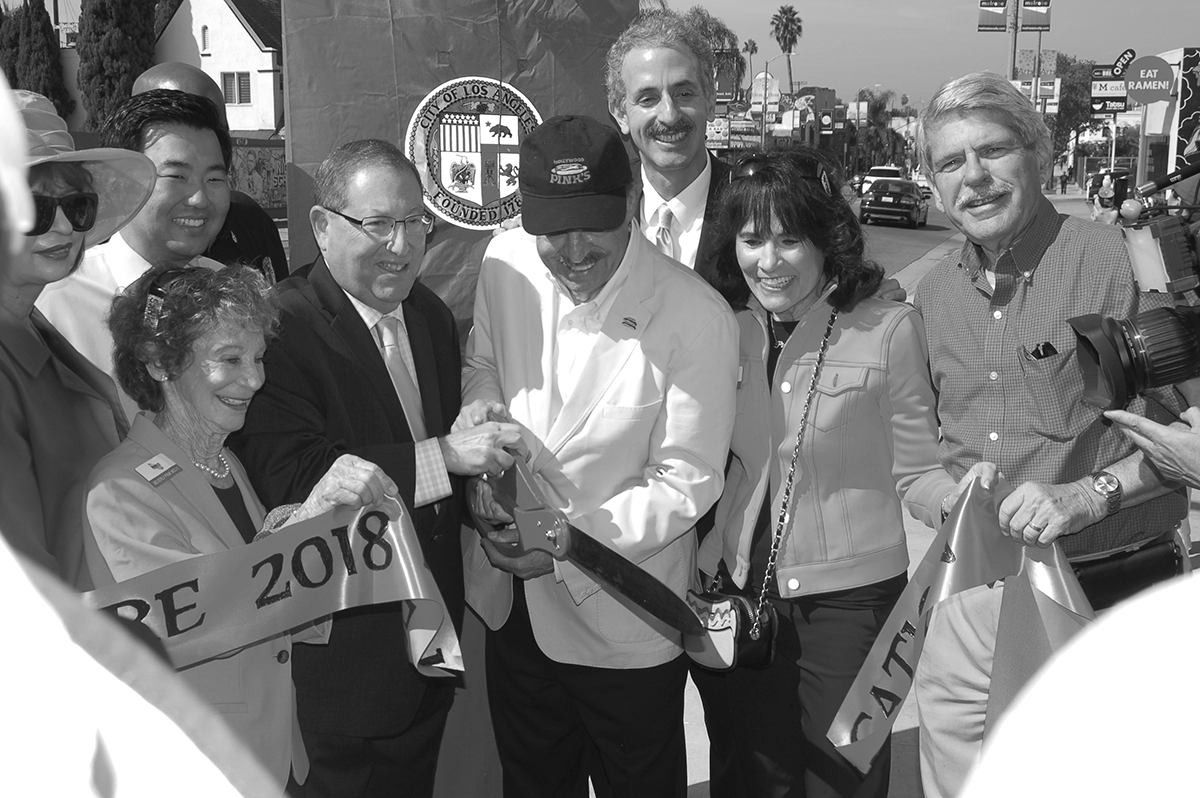 Joining the ribbon cutting at Pink's Square were Richard, Gloria and Beverly Pink, former L.A. County Supervisor Zev Yaroslavsky, City Attorney Mike Feuer, Councilmen Paul Koretz and David Ryu, and Los Angeles Times columnist Patt Morrison. (photo by Edwin Folven)