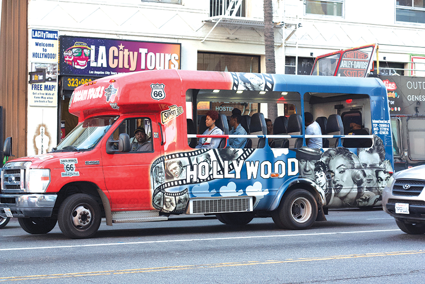 Tour buses are a frequent sight around Hollywood Boulevard. (photo by Jose Herrera)