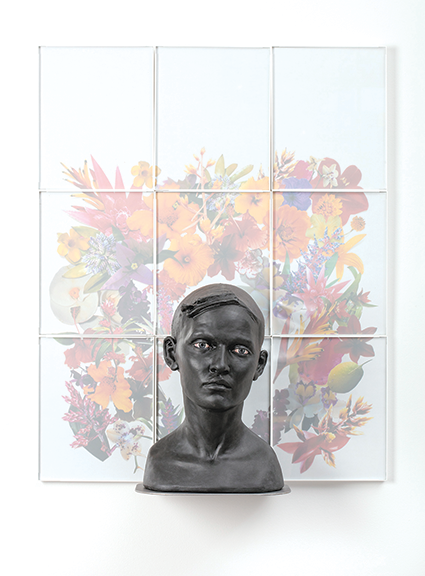 """Cristina Córdova's """"Cabeza V"""" (2018) is a ceramic and framed photo piece on display at the exhibit. (photo courtesy of Craft in America Center)"""