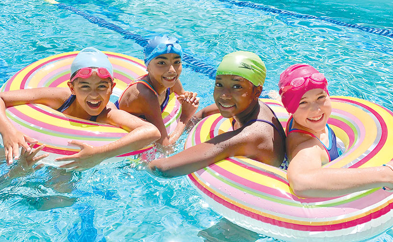 Immaculate Heart sixth graders Madeline Vega (left), Lola Jefferson, Jade Jackson and Haloe Ball enjoyed fun activities in the pool during last year's summer school swim class. (photo courtesy of Immaculate Heart)