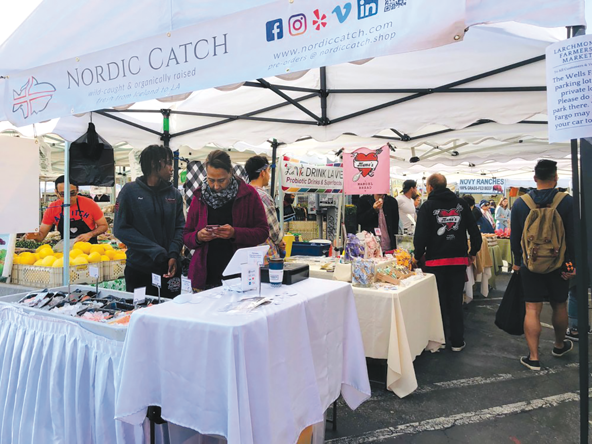 The public can purchase fresh produce, flowers and other goods from the merchants at the Larchmont Farmers' Market, which will remain on Sundays in the 200 block of North Larchmont Boulevard. (photo courtesy of the Larchmont Farmers' Market)