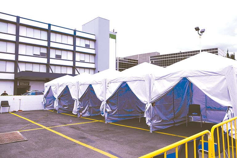 Visitors, doctors, employees and visitors entering the hospital will be examined in triage tents outside Olympia Medical Center. (photo by Jeffrey Adams, Olympia Medical Center)