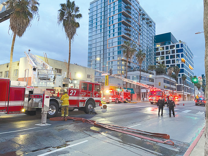 Firefighters staged their equipment on Sunset Boulevard while they extinguished a blaze on March 1. (photo by Edwin Folven)