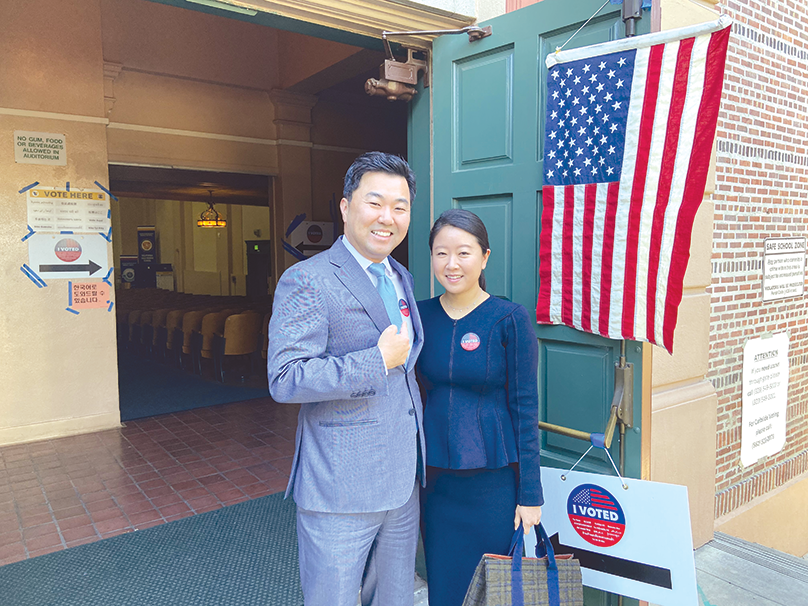 Incumbent candidate Los Angeles City Councilman David Ryu and his wife Regina voted on March 3 in a voting center at John Burroughs Middle School, the councilman's alma mater. (photo by Edwin Folven)