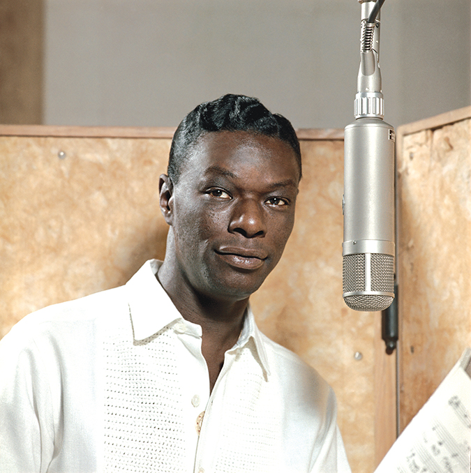 Nat King Cole records in the studio. (photo courtesy of Capitol Photo Archives)