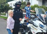 Motorcycle officer brightens day for young supporter