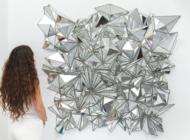 Exhibit places decorative glass pieces in sharp focus