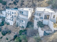 Feuer charges owners of unfinished hillside homes